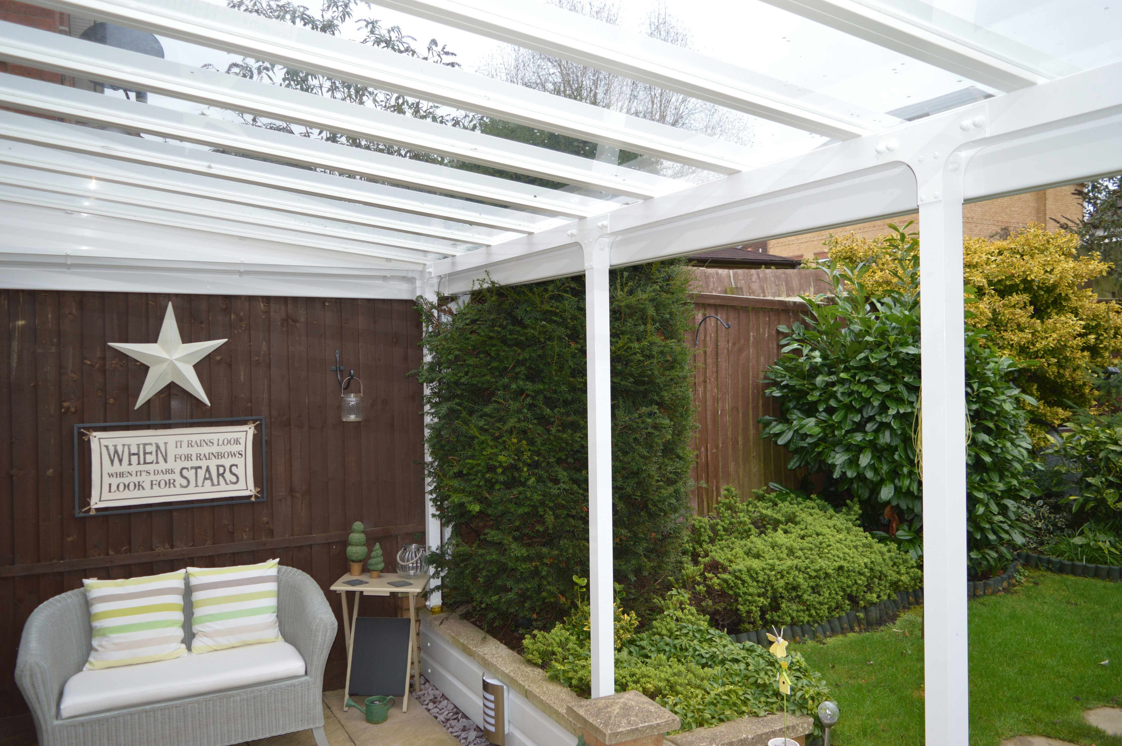 Photo of underneath a white Elegance Glass roofed canopy