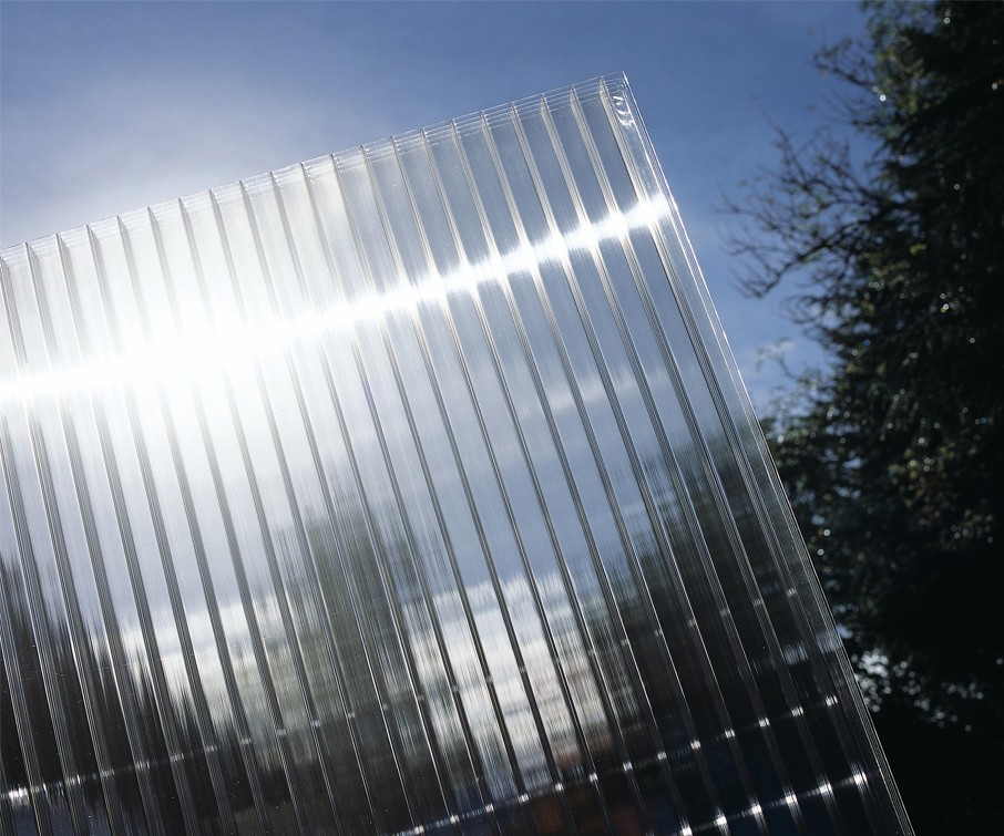 Clear Polycarbonate Sheet held up to the sky to illustrate optical clarity